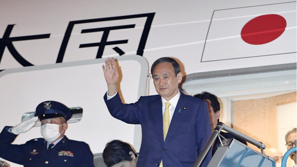 Suga arrives in Vietnam in 1st foreign travel as Japan PM