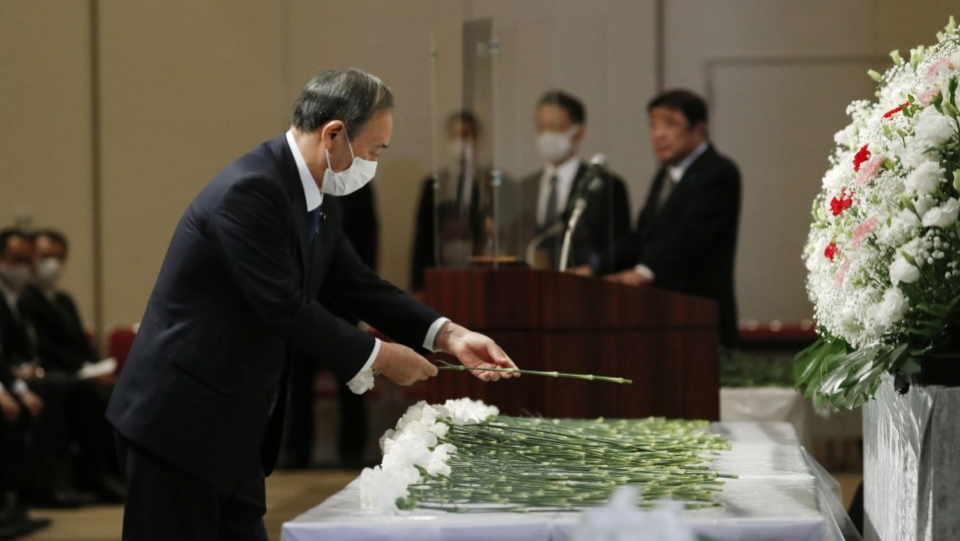 PM Suga attends memorial for father of North Korea abductee