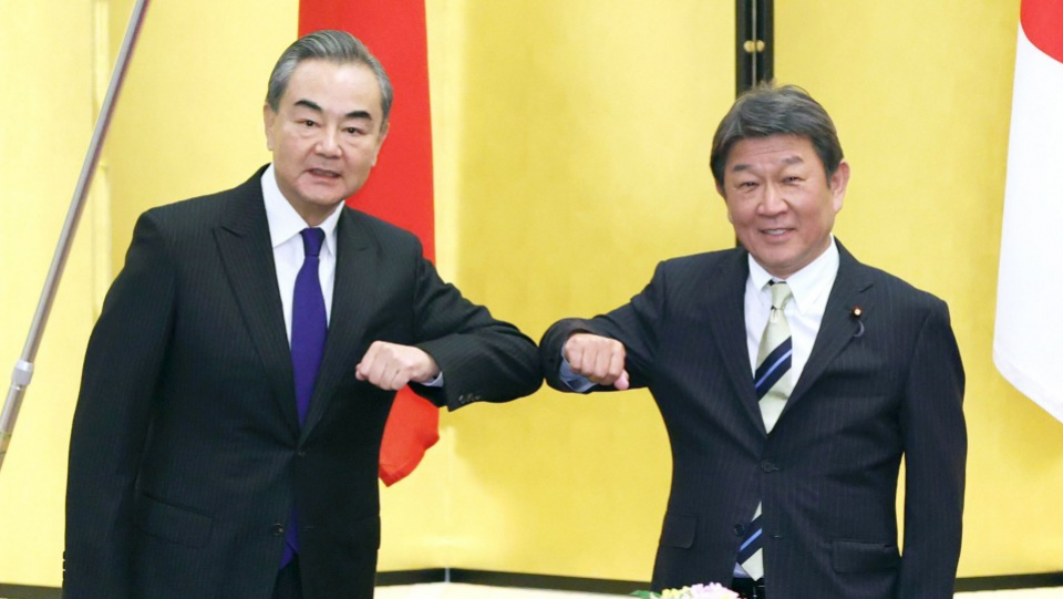 China's foreign minister asks Japanese counterpart to visit
