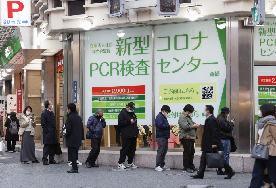 Japan to extend travel subsidy scheme amid record deaths, severe cases