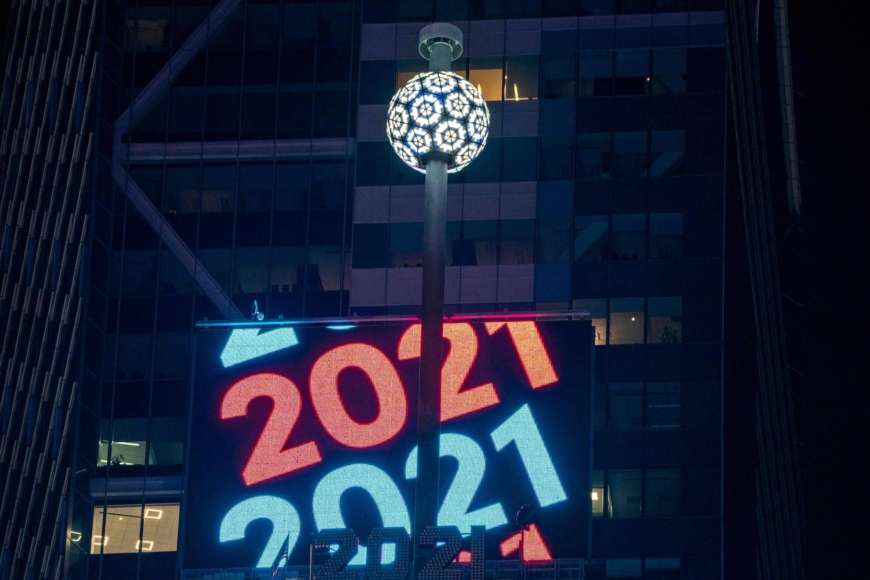 World ushers in New Year under shadow of COVID-19