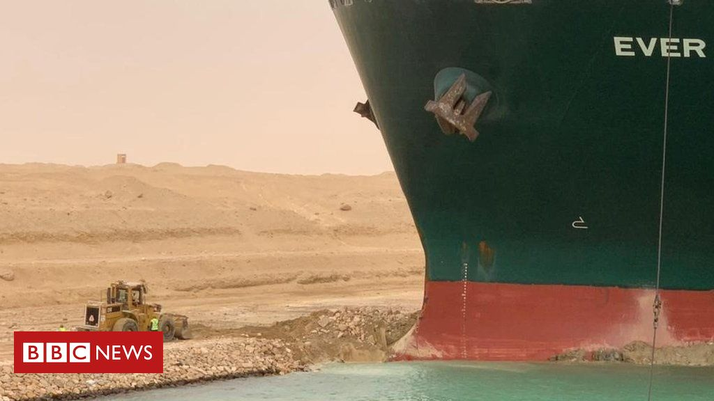 Suez Canal: Owner of cargo ship blocking waterway apologises