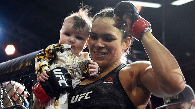 Amanda Nunes celebrated in the octagon with her daughter after beating Megan Anderson