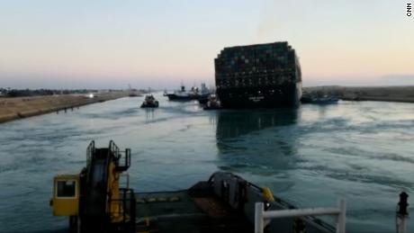 A video sent to CNN from employees working on the rescue operation shows the back of the Ever Given dislodged from the Suez Canal bank on March 29.