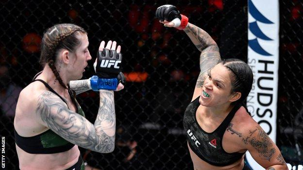 Amanda Nunes of Brazil (right) punches Megan Anderson of Australia in their UFC featherweight championship fight during the UFC 259 event in Las Vegas