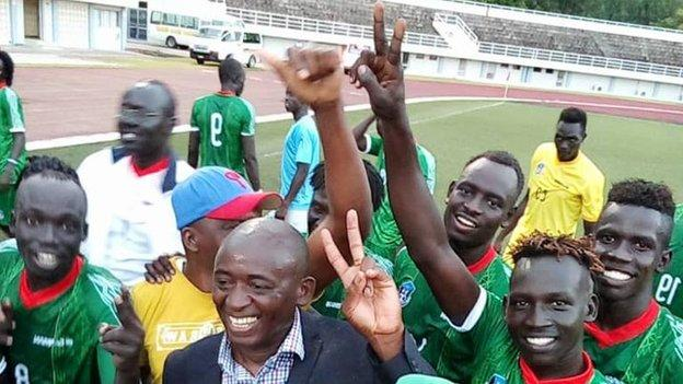 South Sudan coach Ashu Cyprian Besong celebrates with his players