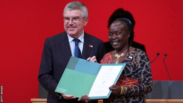 International Olympic Committee president Thomas Bach (left) with Kenya's Tegla Loroupe