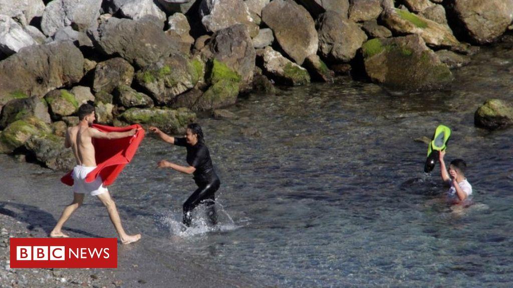 Over 100 Moroccan migrants swim to Spain's Ceuta enclave