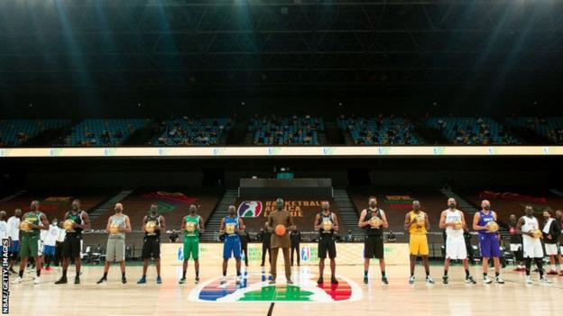 Basketball Africa League president Amadou Gallo Fall (centre) with the captains of the 12 teams taking part in the inaugural league