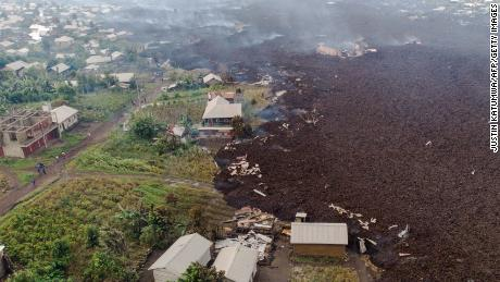 An aerial view shows debris engulfing buildings in Bushara village, near Goma, on May 23.