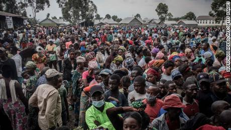 Residents displaced by the Mount Nyiragongo eruption wait to register to receive aid distributed by a local politician and businessman in Goma on May 26.