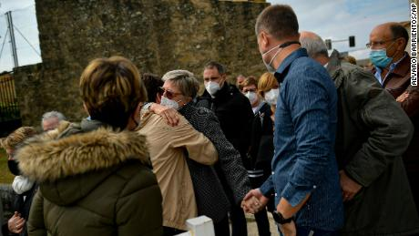 Angelines Amatraiain, center, David Beriain's mother, is hugged by a wellwisher, during a minute of silence in his birthplace of Artajona, northern Spain, on Wednesday.