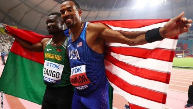 Burkina Faso triple jumper Hugues Fabrice Zango (left) celebrating at the 2019 World Championships with American Christian Taylor