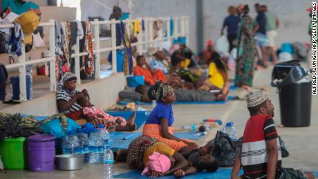 Internally displaced people (IDP) from Palma gather in the Pemba Sports center to receive humanitarian aid in Pemba on April 2, 2021. - People were evacuated from the coasts of Palma after armed insurgents attacked the city on March 24, 2021.