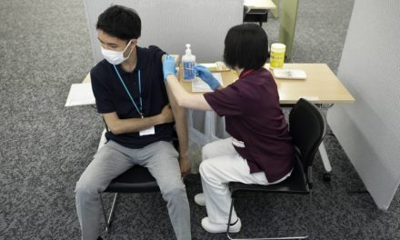 Japan suspends applications for corporate vaccination drives