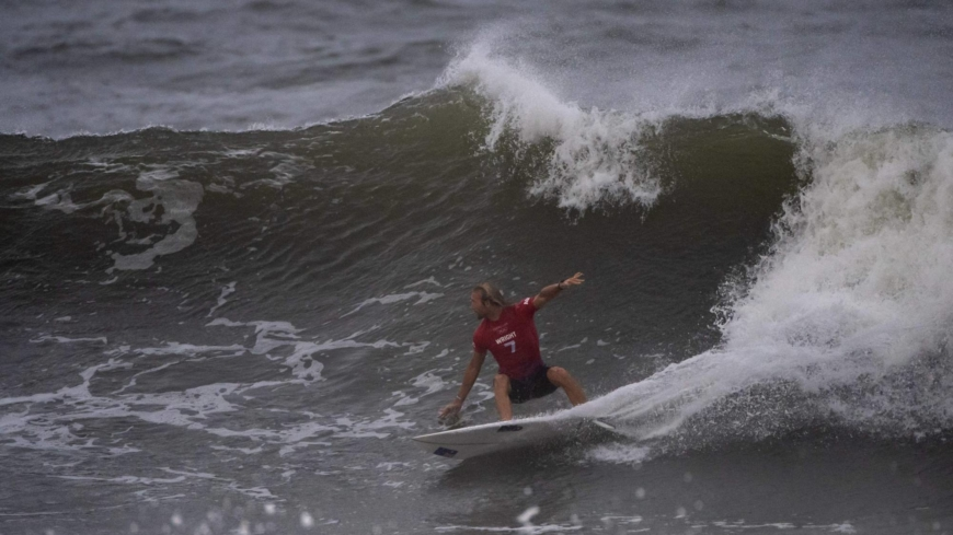 Olympic surfing medals to be decided early, softball in focus as storm churns off Japan