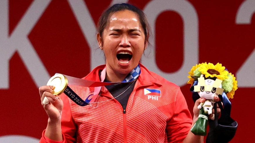 Weightlifter makes history, securing the Philippines' first Olympic gold medal