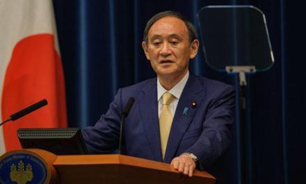 Suga denies impact of holding Olympics on virus surge