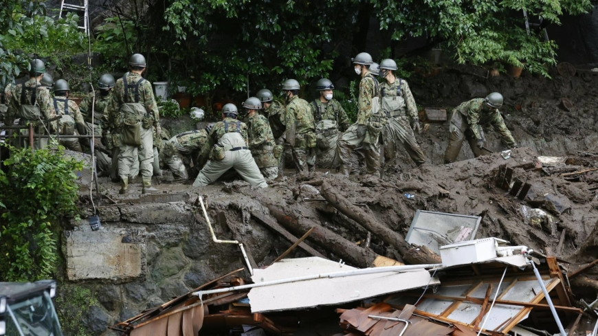Risk of another calamity hampers search for mudslide victims in Japan