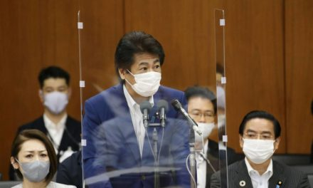 Japan signals chance of rolling back controversial COVID-19 hospital policy